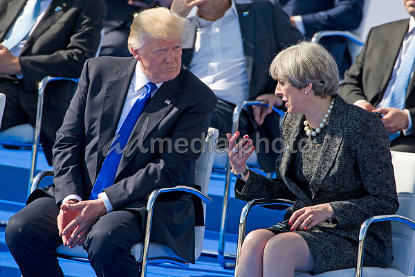 British Prime Minister confronts the US President at the Nato summit. British Prime Minister Theresa May and US President Donald Trump during the handed over ceremony of the new headquarters to Nato on 25 May 2017 in Brussels. May confronts Trump. US media had published confidential investigation details on the terrorist assassination attempt in Manchester. Photo Credit: Stocki/face to face/AdMedia