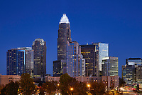 Night view of the Charlotte, North Carolina skyline showcasing the white crown of the Bank of America Corporate Center building