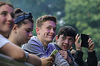 Supporters watch Winner of Redbourne Battle of the Bands, Arccos, performing during AmpRocks 2017, part of Ampthill Festival, at Ampthill Great Park, Ampthill, England on 30 June 2017. Photo by David Horn.