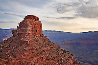 Oneill Butte and dramatic clouds at sunrise, on the South Kaibab Trail in the Grand Canyon.