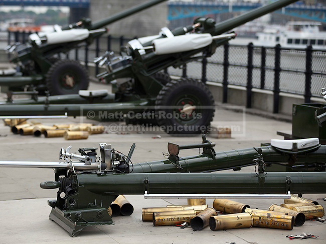 LONDON, UK  02/06/11. Spent cases litter the ground behind guns after members of the Honourable Artillery Company (HAC) fire a 62 gun salute at the Tower of London to mark the anniversary of the Queen's ascension to the throne in 1953. Photo credit should read Matt Cetti-Roberts