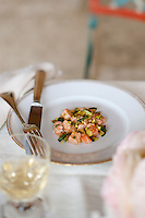A light lunch consisting of oregano scented salmon and courgettes, topped with pistachios and rose oil