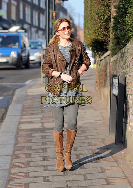 Geri Halliwell.spotted in London, England..March 5th, 2013.full length brown leather jacket sunglasses shades blue knitted grey gray top sweater jumper dress tights boots hand in pocket.CAP/AOU.©AOU/Capital Pictures.