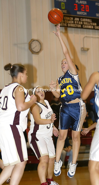 WATERBURY, CT,  02 JANUARY 2006, 010207BZ17- Kennedy's Kasiana Goodman (20) shoots over  Sacred Heart defensers during their game at Sacred Heart High School in Waterbury Tuesday.<br /> Jamison C. Bazinet Republican-American