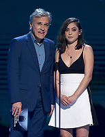 LOS ANGELES - DECEMBER 6: Presenters Christoph Waltz and Rosa Salazar appear onstage at the 2018 Game Awards at the Microsoft Theater on December 6, 2018 in Los Angeles, California. (Photo by Frank Micelotta/PictureGroup)