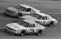 Dale Earnhardt (#3) races 3-wide with Geoff Bodine (#5) and benny Parsons (#55) during the Motorcraft 500 at Atlanta in March 1986.(Photo by Brian Cleary)