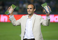 CARSON, CA - October 16, 2011: LA Galaxy midfielder Landon Donovan shows his Galaxy's Most Valuable Player and Golden Boot Awards after the match between LA Galaxy and Chivas USA at the Home Depot Center in Carson, California. Final score LA Galaxy 1, Chivas USA 0.