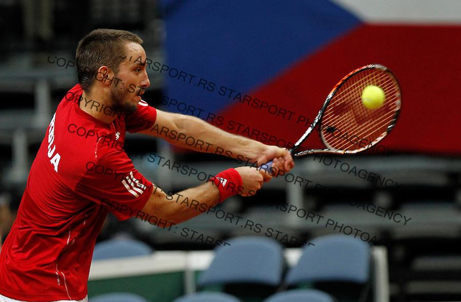 Davis Cup.Czech Republic Vs. Serbia.Lukas Rosol Vs. Viktor Troicki.Viktor Troicki returnes the ball.Prague, 08.04.2012..foto: Srdjan Stevanovic/Starsportphoto ©
