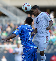 Cuba's Joel Colomé heads the ball over El Salvador's Xavier Garcia.  El Salvador defeated Cuba 6-1 at the 2011 CONCACAF Gold Cup at Soldier Field in Chicago, IL on June 12, 2011.