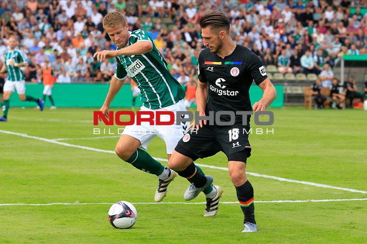 11.08.2019, Stadion Lohmühle, Luebeck, GER, DFB-Pokal, 1. Runde VFB Lübeck vs 1.FC St. Pauli<br /> <br /> DFB REGULATIONS PROHIBIT ANY USE OF PHOTOGRAPHS AS IMAGE SEQUENCES AND/OR QUASI-VIDEO.<br /> <br /> im Bild / picture shows<br /> Tommy Grupe (VfB Luebeck) im Zweikampf gegen Dimitrios Diamantakos (FC St. Pauli)<br /> <br /> Foto © nordphoto / Tauchnitz