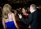 Washington, D.C. - April 21, 2007 - United States Secretary of State Condoleezza Rice (C) speaks with Larry King (R) and other guests at the White House Correspondents Association Dinner April 21, 2007 in Washington, DC.  Comedian Rich Little hosted and provided entertainment for President George W Bush, White House reporters, their guests and celebrities.  Credit: Brendan Smialowski - Pool via CNP