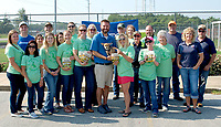Janelle Jessen/Herald-Leader<br /> Simmons Pet Food kicked off its Dog Days of Summer Treat Giveaway at the Siloam Springs Animal Shelter on Tuesday.