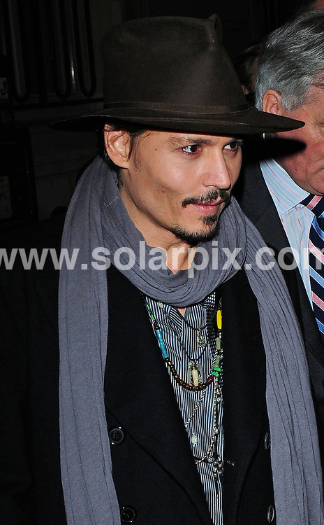 **ALL ROUND PICTURES FROM SOLARPIX.COM**.**WORLDWIDE SYNDICATION RIGHTS**.attends the Paris premiere of 'Sweeney Todd'.  Held at Gaumont Champs Elysees Marignan, Paris. 16th January 2008..This pic: Johnny Depp...JOB REF: 5610 SSD     DATE: 16_01_2008.**MUST CREDIT SOLARPIX.COM OR DOUBLE FEE WILL BE CHARGED* *UNDER NO CIRCUMSTANCES IS THIS IMAGE TO BE REPRODUCED FOR ANY ONLINE EDITION WITHOUT PRIOR PERMISSION*