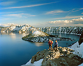 USA, Oregon, couple hiking with snowcapped mountains, Crater Lake National Park