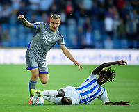 Lincoln City's Harry Anderson battles with Huddersfield Town's Trevoh Chalobah<br /> <br /> Photographer Andrew Vaughan/CameraSport<br /> <br /> The Carabao Cup First Round - Huddersfield Town v Lincoln City - Tuesday 13th August 2019 - John Smith's Stadium - Huddersfield<br />  <br /> World Copyright © 2019 CameraSport. All rights reserved. 43 Linden Ave. Countesthorpe. Leicester. England. LE8 5PG - Tel: +44 (0) 116 277 4147 - admin@camerasport.com - www.camerasport.com