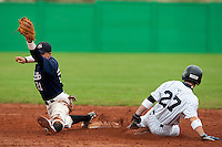 10 october 2009: Yann Dal Zotto of Savigny stretches for the ball as Joris Bert of Rouen slides into second base during game 4 of the 2009 French Elite Finals won 7-2 by Huskies of Rouen over Lions of Savigny, at Stade Jean Moulin stadium in Savigny sur Orge, near Paris, France. Rouen wins the 2009 France championship, his sixth title.