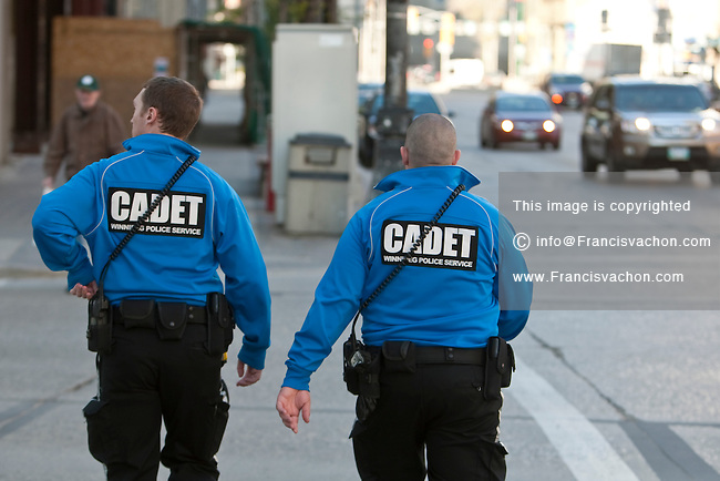Winnipeg Police Service Cadet patrol Portage Avenue in Winnipeg Wednesday May 25, 2011.