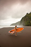 USA, Hawaii, The Big Island, paddle boarder Donica Shouse in the lush Waipio Valley
