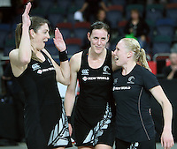 20.09.2012 Silver Ferns Irene Van Dyk, Leana de Bruin and Laura Langman celebrate during the second netball test match between the Silver Ferns and the Australian Diamonds played at Vector Arena in Auckland. Mandatory Photo Credit ©Michael Bradley.