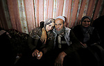Relatives of Palestinian Haitham al-Jamal, 15, who was shot dead by Israeli troops during clashes, mourn during his funeral in Rafah in the southern Gaza Strip on June 9, 2018. Four Palestinians were killed by Israeli fire on the Gaza border on June 8, the territory's health ministry said giving a new toll, as weeks of deadly clashes with protesters continued. Photo by Ramadan Elagha