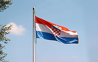 The Croatian flag banner on a flag pole. Dubrovnik region. Dalmatian Coast, Croatia, Europe.