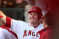 Los Angeles Angels first baseman Mark Trumbo #44 is greeted by teammates after hitting a home run against the Baltimore Orioles at Angel Stadium on August 20, 2011 in Anaheim,California. Los Angeles defeated Baltimore 9-8.(Larry Goren/Four Seam Images)