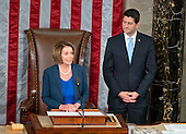 Incoming Speaker of the United States House of Representatives Paul Ryan (Republican of Wisconsin), right, listens as former Speaker of the US House of Representatives and current US House Minority Leader Nancy Pelosi (Democrat of California), left, makes remarks in the US House Chamber in the US Capitol in Washington, DC on Thursday, October 29, 2015.<br /> Credit: Ron Sachs / CNP
