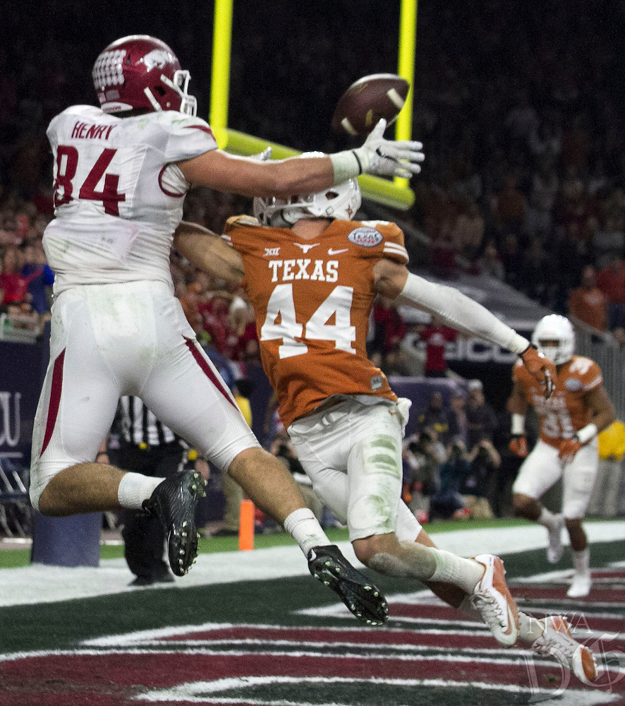 Arkansas Democrat-Gazette/BENJAMIN KRAIN --12/29/14--<br /> Texas defender Dylan Haines prevents Hunter Henry from a touchdown catch in the 2nd quarter of the Razorbacks Texas Bowl victory Monday night at NRG Stadium in Houston.