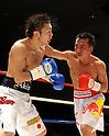 (L-R) Akira Yaegashi (JPN), Pornsawan Porpramook (THA), OCTOBER 24, 2011 - Boxing : Pornsawan Porpramook of Thailand hits Akira Yaegashi of Japan during the eighth round of the WBA minimumweight title bout at Korakuen Hall in Tokyo, Japan. (Photo by Mikio Nakai/AFLO)