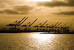 Oakland, California: Container ship cranes at dawn in Port of Oakland. Photo 16-casanf78504. Photo copyright Lee Foster.