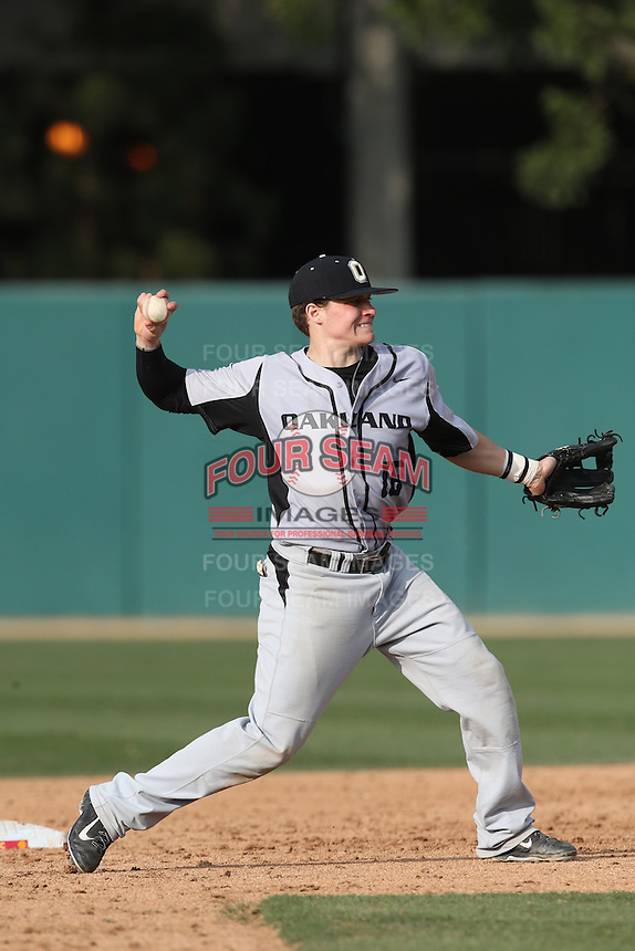 Ian Yetsko (16) of the Oakland Grizzlies in the field during a game against the Southern California Trojans at Dedeaux Field on February 21, 2015 in Los Angeles, California. Southern California defeated Oakland, 11-1. (Larry Goren/Four Seam Images)