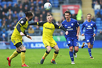 Craig Bryson of Cardiff City is challenged by Jamie Allen of Burton Albion during the Sky Bet Championship match between Cardiff City and Burton Albion at the Cardiff City Stadium, Wales, UK. Friday 30 March 2018