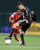 Branko Boskovic #27 of D.C. United stops the ball in front of Julian de Guzman #6 of Toronto FC during an MLS match that was the final appearance of D.C. United's Jaime Moreno at RFK Stadium, in Washington D.C. on October 23, 2010. Toronto won 3-2.