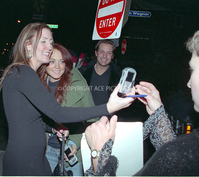New York, December 3, 2004: Lindsay Lohan got surrounded by young fans as she exited Pasti's Restaurant after having dinner with friends. It took Lohan good 5 minutes to pose for pictures with all fans who asked her. There she was posing with fans while her bodyguard kept snapping away with fans' cameras. Lohan was very nice and did not say 'no' to any one. Please byline: Boldeskul/Bocklet/ACE PICTURES... *** ***  ..Ace Pictures, Inc:  ..Alecsey Boldeskul (646) 267-6913 ..Philip Vaughan (646) 769-0430..e-mail: info@acepixs.com..web: http://www.acepixs.com