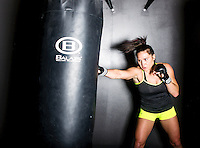MMA fighter Cat Zingano (cq) trains at a MusclePharm gym in Denver, Colorado, Friday, November 7, 2014. In 2013, Zingano became the first woman to win a UFC fight by technical knockout and is currently the number three ranked pound-for-pound female MMA fighter in the world.<br /> <br /> Photo by Matt Nager