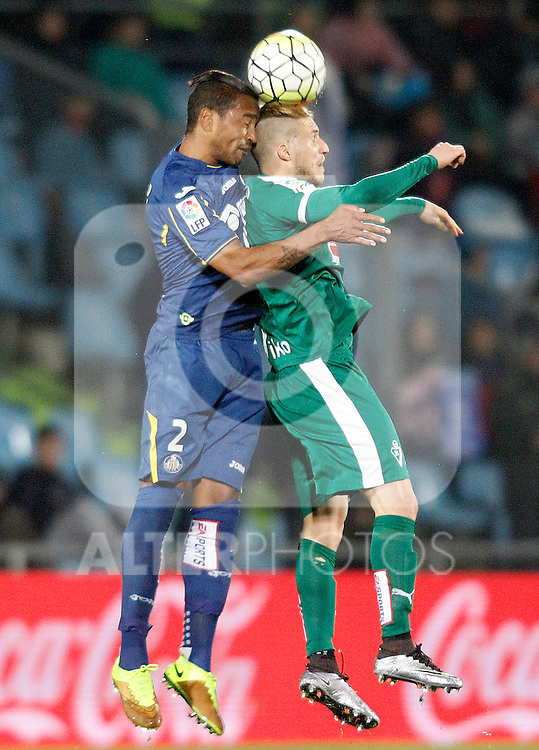 Getafe's Alvaro Pereira (l) and Sociedad Deportiva Eibar's Keko Gontan during La Liga match. March 18,2016. (ALTERPHOTOS/Acero)