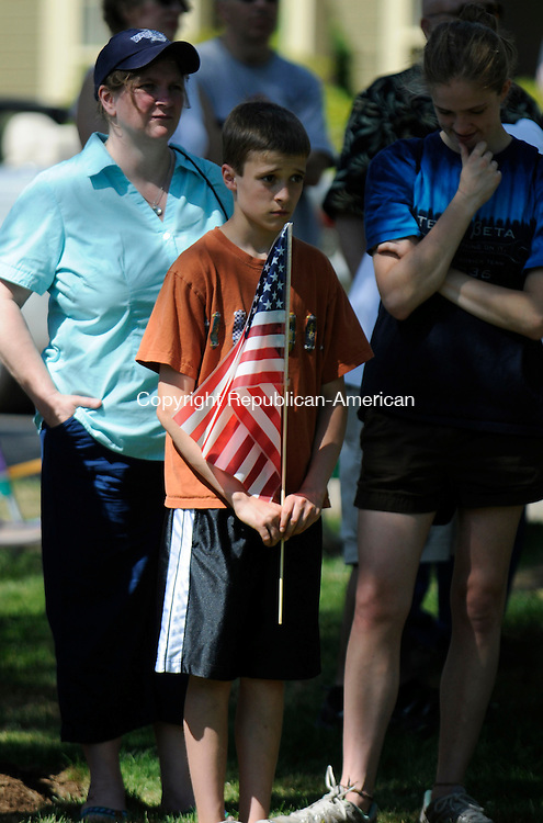WOODBURY, CT-30 MAY 2010-053010IP01- (l to r) Danielle Michener of Woodbury and her kids Phil Michener, 12, and Carolyn Michener, 16, listen during a Memorial Day ceremony at Cannon Green in Woodbury on Sunday.                                                                                                                                                                                                                                                                                                                                                                                                                                                                                                                                                                                                                                                                                                                                                                                                                                                                                                                                                                                                                                                                                                                                                                    <br /> Irena Pastorello Republican-American