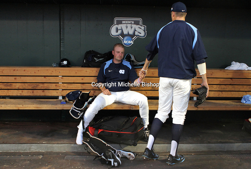 North Carolina's Chase Jones is consoled by a teammate after Vanderbilt's 5-1 win eliminated UNC from the College World Series in Omaha, Neb. (Photo by Michelle Bishop)..