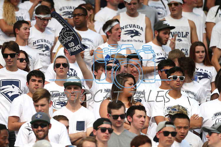 Frustrated Nevada football fans watch a 44-20 loss to Arizona in Reno, Nev., on Saturday, Sept. 12, 2015.(AP Photo/Cathleen Allison)