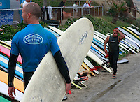 Saturday, June 14, 2008, Tourmaline Surf Park, Pacific Beach, San Diego, CA, USA.  Competitors pass a long line of boards during the Pacific Beach Surf Club's Tenth Annual Longboard Classic at Tourmaline Surfing Park.  The event was well attended despite gray, June gloom clouds and fickle, windy surf conditions.