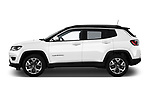 Car driver side profile view of a 2017 Jeep Compass Limited 5 Door SUV
