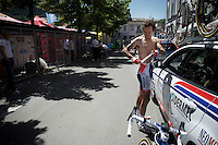 Franco Pellizotti (ITA/Androni Giocattoli-Sidermec)<br /> getting rid of an underlayer just before the race start as it is already pretty warm in the start town of Tirano. Unlike 'bigger teams' Pellizotti's kit doesn't have a designated race radio pocket, so he has to attach a handkerchief to his trunks that will carry the radio.<br /> <br /> stage 17: Tirano - Lugano (SUI) (134km)<br /> 2015 Giro d'Italia