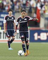 New England Revolution midfielder Lee Nguyen (24) evaluates the situation. In a Major League Soccer (MLS) match, the New England Revolution (blue) tied D.C. United (white), 0-0, at Gillette Stadium on June 8, 2013.