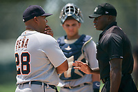 GCL Tigers West manager Brayan Pena (28) talks with home plate umpire Tre Jester while catcher Eliezer Alfonzo (35) looks on during a game against the GCL Pirates on August 13, 2018 at Pirate City Complex in Bradenton, Florida.  GCL Tigers West defeated GCL Pirates 5-1.  (Mike Janes/Four Seam Images)