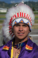Native American Man wearing Feather Headdress, Auburn, Washington, USA.