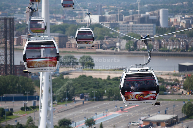 28/06/2012. LONDON, UK. Emirates Air-Line cabins are seen in action over East London today (28/06/12) at the launch of London's first cable car system. The new cable car system, running across the River Thames between the Greenwich Peninsula and the Royal Docks in East London, was today opened to the public, despite fears that it would not be ready in time for the London 2012 Olympics. Photo credit: Matt Cetti-Roberts