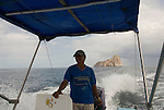 this tourist boat is moving from kicker rock san cristobal galapagos