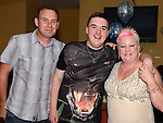 Dean Simpson celebrating his 18th birthday in the Thatch with friend parents Leslie and Kate. Photo:Colin Bell/pressphotos.ie