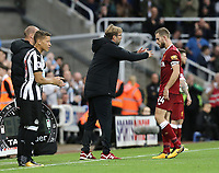 Liverpool manager Jurgen Klopp gives instructions to Jordan Henderson<br /> <br /> Photographer Rich Linley/CameraSport<br /> <br /> The Premier League -  Newcastle United v Liverpool - Sunday 1st October 2017 - St James' Park - Newcastle<br /> <br /> World Copyright &copy; 2017 CameraSport. All rights reserved. 43 Linden Ave. Countesthorpe. Leicester. England. LE8 5PG - Tel: +44 (0) 116 277 4147 - admin@camerasport.com - www.camerasport.com