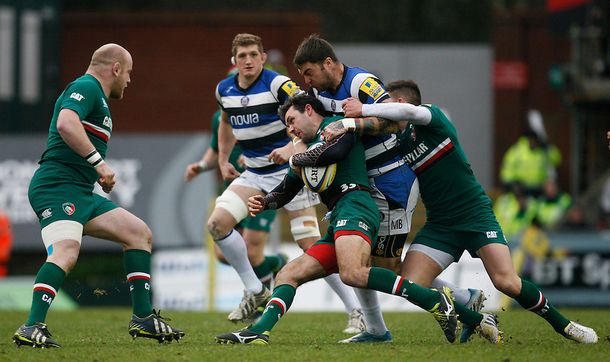 Bath Rugby's Matt Banahan (2nd R) tackles Leicester Tigers' Niall Morris <br /> <br /> Photo by Jack Phillips/CameraSport<br /> <br /> Rugby Union - Aviva Premiership - Leicester Tigers v Bath Rugby - Sunday 5th January 2014 - Welford Road - Leicester<br /> <br /> &copy; CameraSport - 43 Linden Ave. Countesthorpe. Leicester. England. LE8 5PG - Tel: +44 (0) 116 277 4147 - admin@camerasport.com - www.camerasport.com
